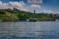 A ferry ship entering a port at lake constance stock photos