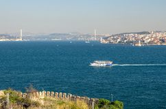 Ferry ships sail up and down the Golden Horn in Istanbul, Turkey royalty free stock images