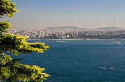 Ferry ships sail up and down the Golden Horn in Istanbul, Turkey royalty free stock photo