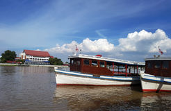 Ferry station and ferry boat on river. royalty free stock photos
