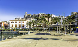 Ferry station in the port of Ibiza with Old Town Stock Photography