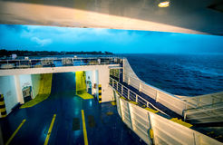 Ferry in the storm. Ferry ship cruising during heavy rain storm Stock Photos