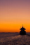 Ferry at sunset Stock Photos