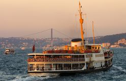 Ferry at sunset on the Bosphorus river in Istanbul, Turkey Royalty Free Stock Image