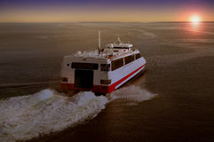 Ferry in sunset. Cruise liner floating away from harbor at dawn Royalty Free Stock Photography