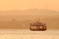 Ferry at sunset, Istanbul, Turkey. Asian side heights of the city are at the background, copy space on top and bottom Stock Photography