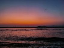 Ferry on sunset moon royalty free stock photo