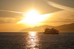Ferry Sunset. This ferry is silhouetted by the sunset as it sets sail across the water Royalty Free Stock Photo