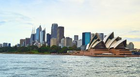 Ferry at Sunset. Sydney Opera House and City View Royalty Free Stock Images