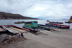 A ferry taking a bus across Lake Titicaca between the Isla del Sol and La Paz. In Bolivia Stock Photography