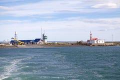 Ferry terminal at Primera Angostura close to Punta Delgada along the Strait of Magellan, Chile. Ferry terminal and lighthouse at Primera Angostura close to Punta stock photo