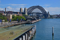 Ferry Terminal wharf with Harbour Bridge in the background Stock Photo