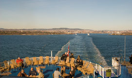Ferry to Denmark. Passengers on the ferry leaving Oslo.The ferry  to Denmark. On the background is city Oslo Stock Images