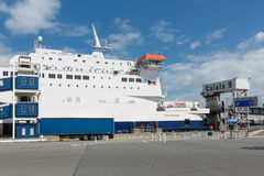 Ferry to England moored at harbor gate in Calais, France. HARBOR CALAIS, FRANCE - JUNE 07, 2017: Ferry to England moored for embarking or disembarking at harbor Stock Images