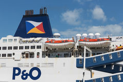 Ferry to England moored at harbor gate in Calais, France. HARBOR CALAIS, FRANCE - JUNE 07, 2017: Ferry to England moored for embarking or disembarking at harbor Royalty Free Stock Photo