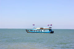 Ferry to Si Chang island. With the flag of Thailand Royalty Free Stock Images