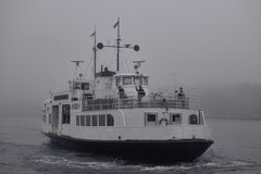 Ferry to Suomenlinna fortress island on foggy afternoon in the Baltic Sea Royalty Free Stock Photo