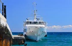 Ferry or tourist cruiser alongside a dock Stock Photography