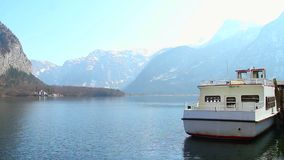 Ferry for tourist transportation, small ship at mountain lake. Stock footage stock video