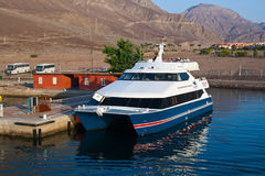 Ferry with tourists before sailing to Jordan. Royalty Free Stock Images