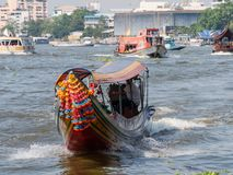 Ferry traffic on the Chao Praya River in Bangkok stock image