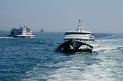 Ferry Traffic on the Thames River Royalty Free Stock Images