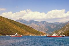 Ferry transportations. Montenegro, ferries run across the narrowest  part of Bay of Kotor -  Verige Straits. Ferry transportations. Montenegro, ferries run Stock Photos