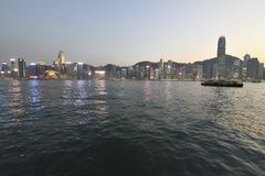 Star Ferry across the Victoria Harbour in early evening of Spring stock photos