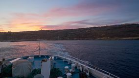 Ferry trip from Gozo to Malta Island. GHAJNSIELEM, MALTA - JUNE 15, 2018: The ferry trip from Gozo to Malta island with a view on harbor, town on the hills and stock video footage