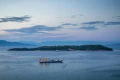 Ferry at Twilight. Sailing ferry at sea near small Greek island Royalty Free Stock Photography