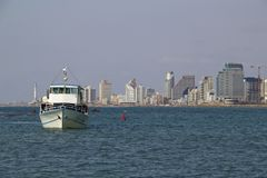 Ferry and  view of city center Tel-Aviv from the Mediterranean Sea Stock Photography