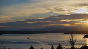 A ferry in the West Seattle sunset stock video footage