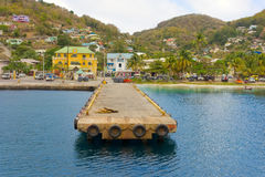 A ferry wharf in the caribbean. A long concrete jetty used by inter-island ships in the windward islands royalty free stock photos