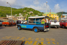 A ferry wharf in the caribbean. Passengers and cargo in a taxi at bequia's waterfront stock photography