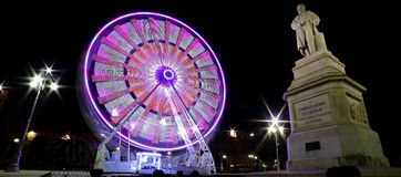 Ferry wheel near Cavour by night royalty free stock images