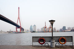 Ferry beside the yangpu bridge at Shanghai Royalty Free Stock Images