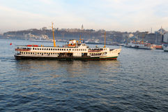 Ferryboat in the Bosphorus. The ship passing in front of Hagia Sophia and Sultan Ahmet Mosque in Istanbul Royalty Free Stock Image