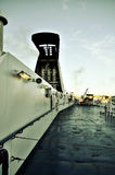 Ferryboat deck. The deck of a ferryboat leaving the port of Genova in the evening light Stock Photo