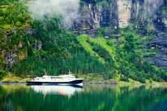 Ferryboat in fiord Stock Photo