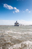 Ferryboat leaves port of Calais Royalty Free Stock Image