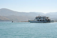 Ferryboat leaving port Stock Photography