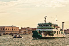 Ferryboat Metamauco and motor boat in Grand Canal in Venice. Venice, Italy - August 21, 2015: Ferryboat Metamauco (IMO 9198434) and motor boat in Grand Canal in Stock Images