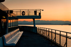 Ferryboat and Olympic Mountains. Aboard a Washington State Ferry traveling to Bainbridge Island during a magnificent sunset on Puget Sound Stock Photos
