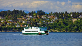 Ferryboat passing by scenic landscape Royalty Free Stock Images