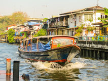 Ferryboat, public motorboat on small channel. Bangkok, Thailand Stock Photos