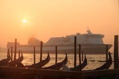 Ferryboat sailing near venetian gondolas Royalty Free Stock Photos
