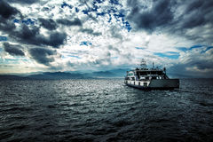 Ferryboat and the Sea in Cloudy Day Stock Photos