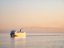 Ferryboat at Sunrise. On the Mediterranean Sea stock photos