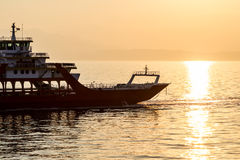Ferryboat transportation at dusk in Mediterranean sea closeup Stock Image