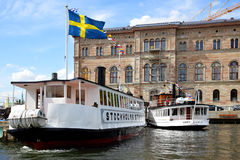 Ferryboats on the berth in Stockholm Stock Images